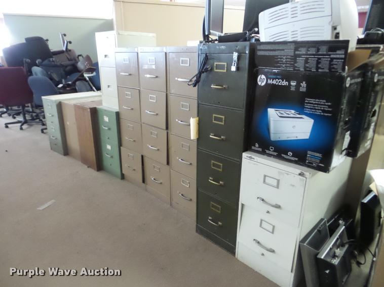 Approximately 25 filing cabinets