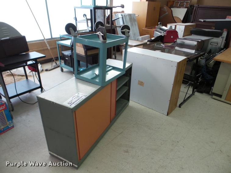 Approximately 9 metal carts and cabinets