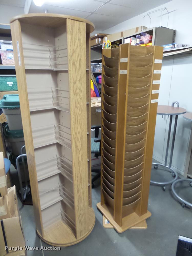 (2) rotating magazine racks