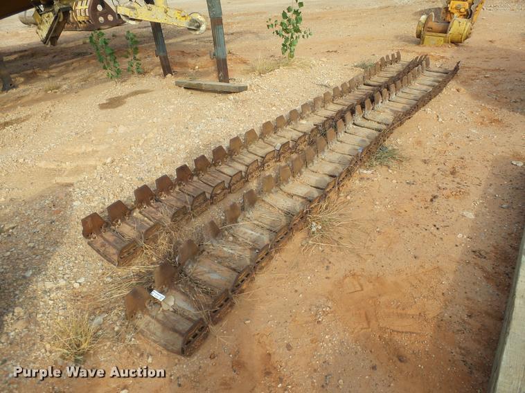 Skid steer over tire tracks