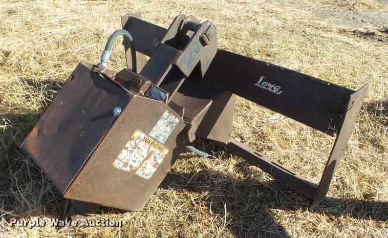 Lowe 1200E skid steer auger