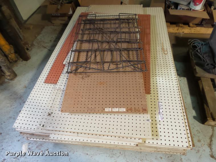 Approximately 25 sheets of pegboard