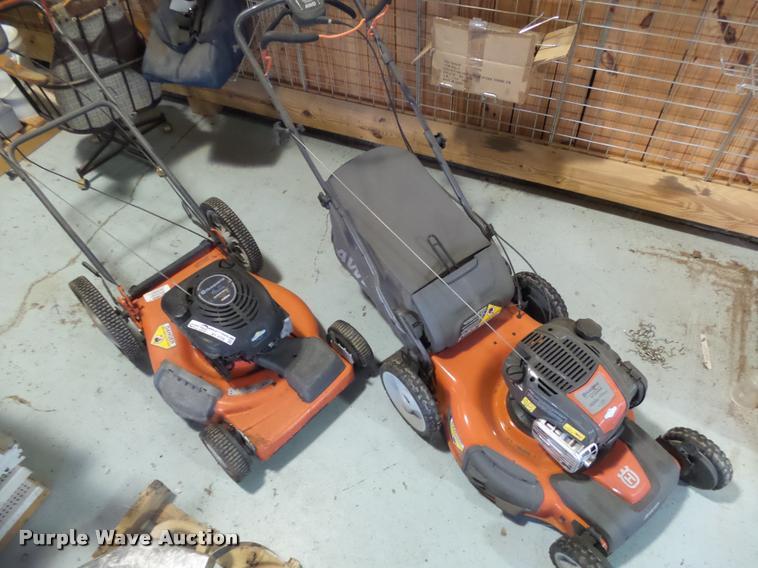 (2) Husqvarna lawn mowers