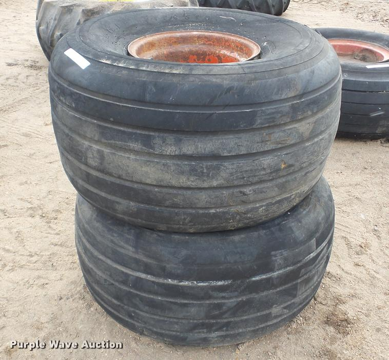 (2) Firestone 21.5L-16.1 tires and wheels