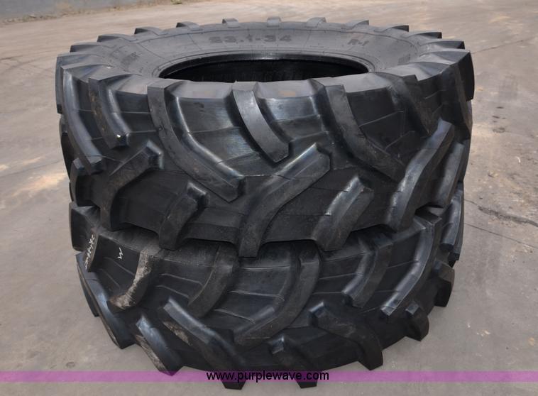 (2) 23.1-26 12PR tractor tires