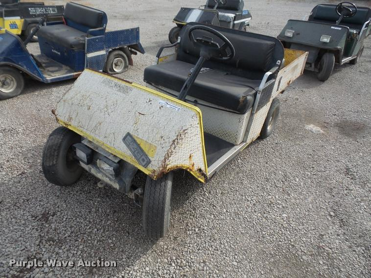 (4) EZ-Go golf carts