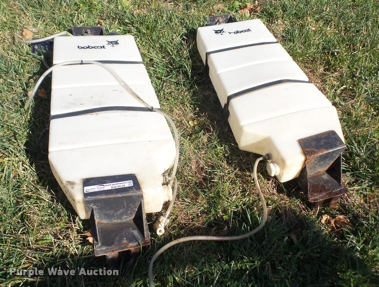 (2) Bobcat liquid tanks