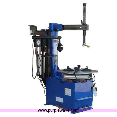 Rim clamp tire machine