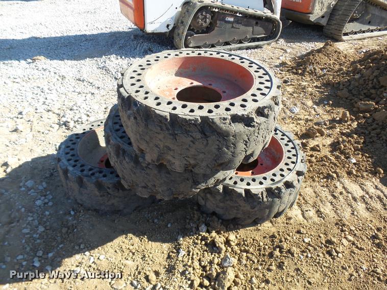(4) solid skid steer tires