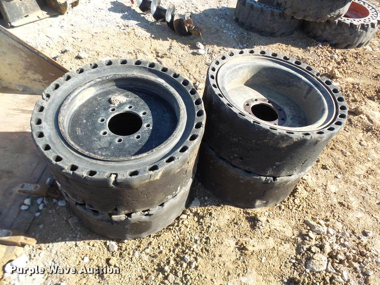 (4) solid skid steer tires and wheels