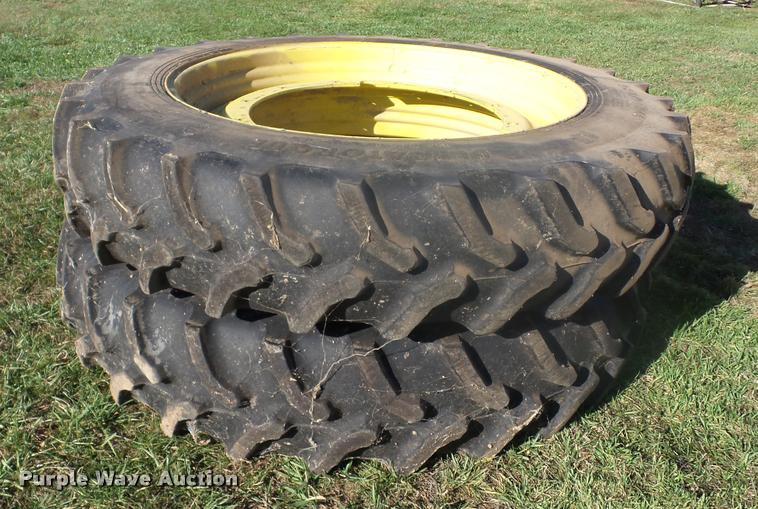 (2) Goodyear 380/90R46 tires and wheels