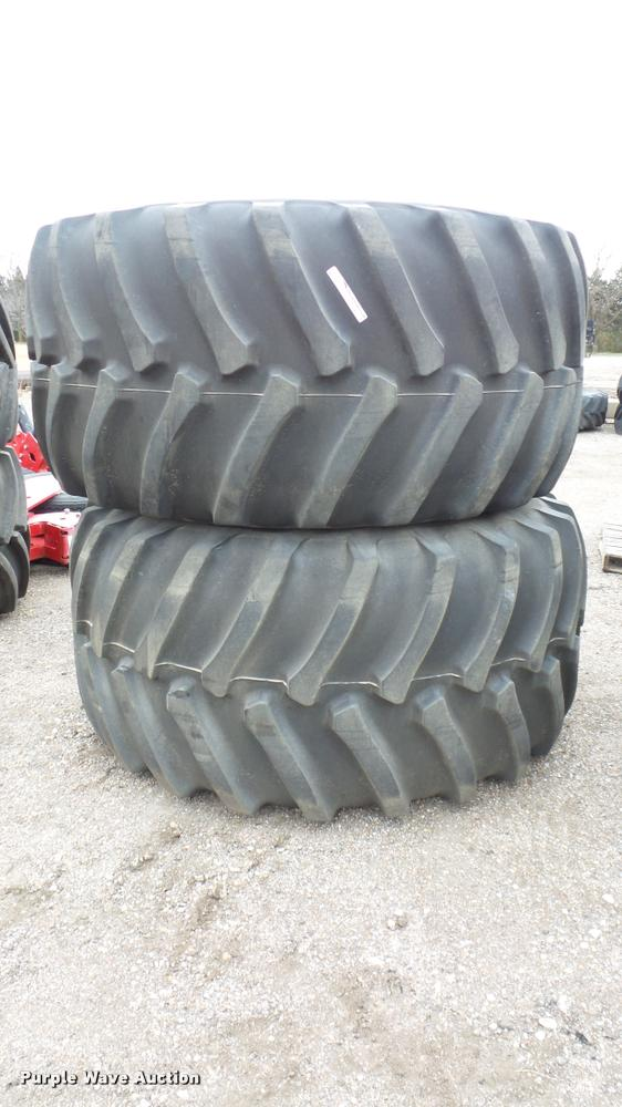 (2) Firestone Radial All Traction tires and wheels