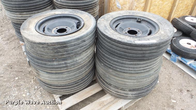 (8) Titan Packer tires and wheels