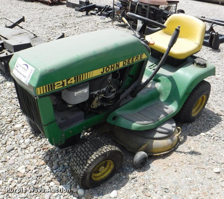 (2) John Deere lawn mowers