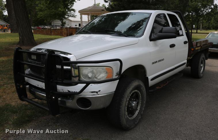 2004 Dodge Ram 2500 Quad Cab flatbed pickup truck