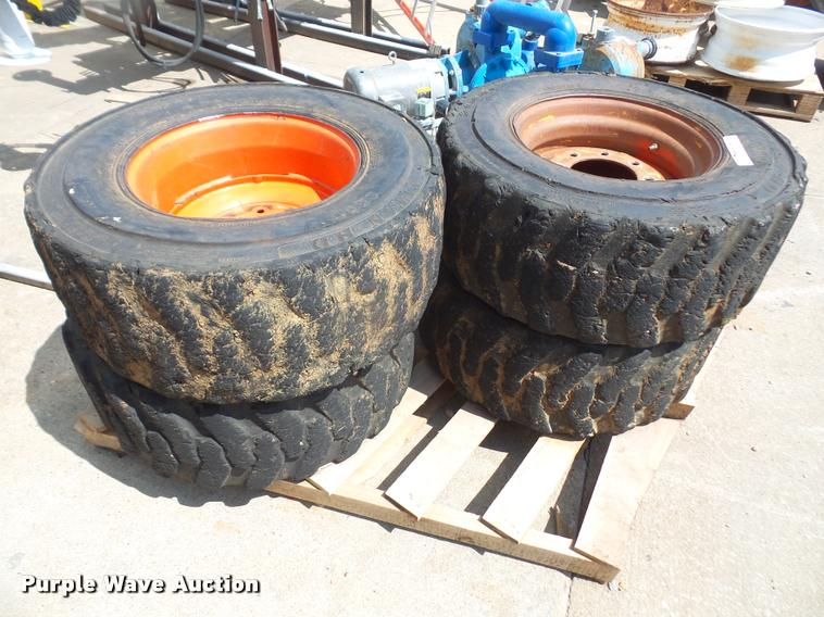 (4) 12-16.5 skid steer tires and wheels