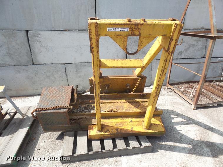 Motor grader winch mounting frame