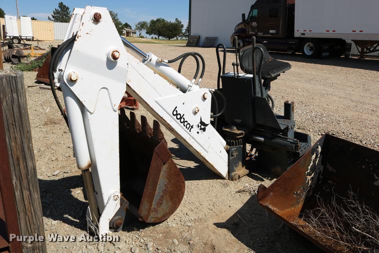Bobcat 909 skid steer backhoe