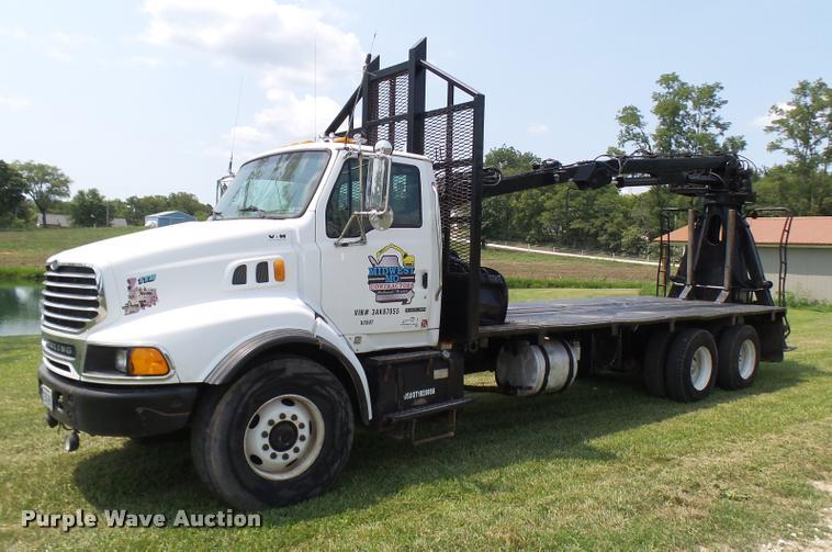 2003 Sterling L9500 grapple crane truck