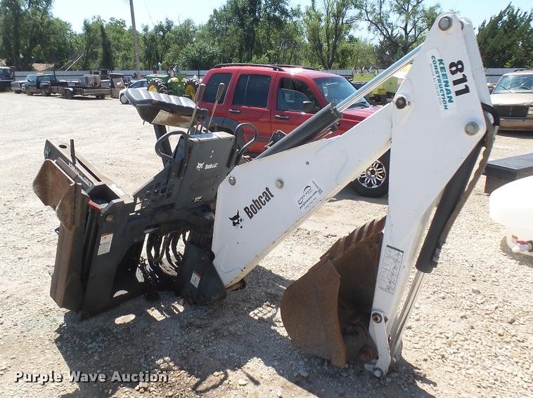 Bobcat 811 skid steer backhoe