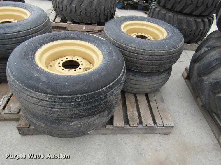 (4) BKT 11L-15 tires with six bolt wheels