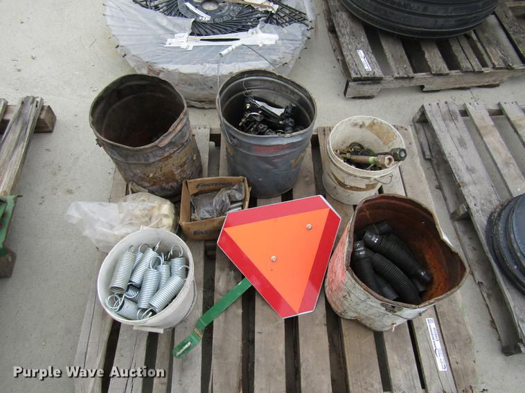 Bushings, pins, springs, sprayer brackets, rubber seed tubes, bolts, and SMU sign
