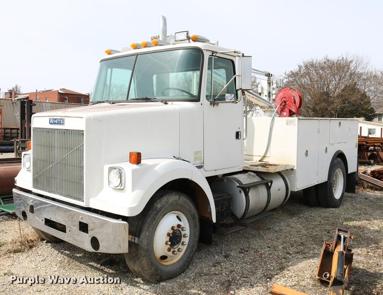 1984 White Volvo WCS 42T service truck with crane