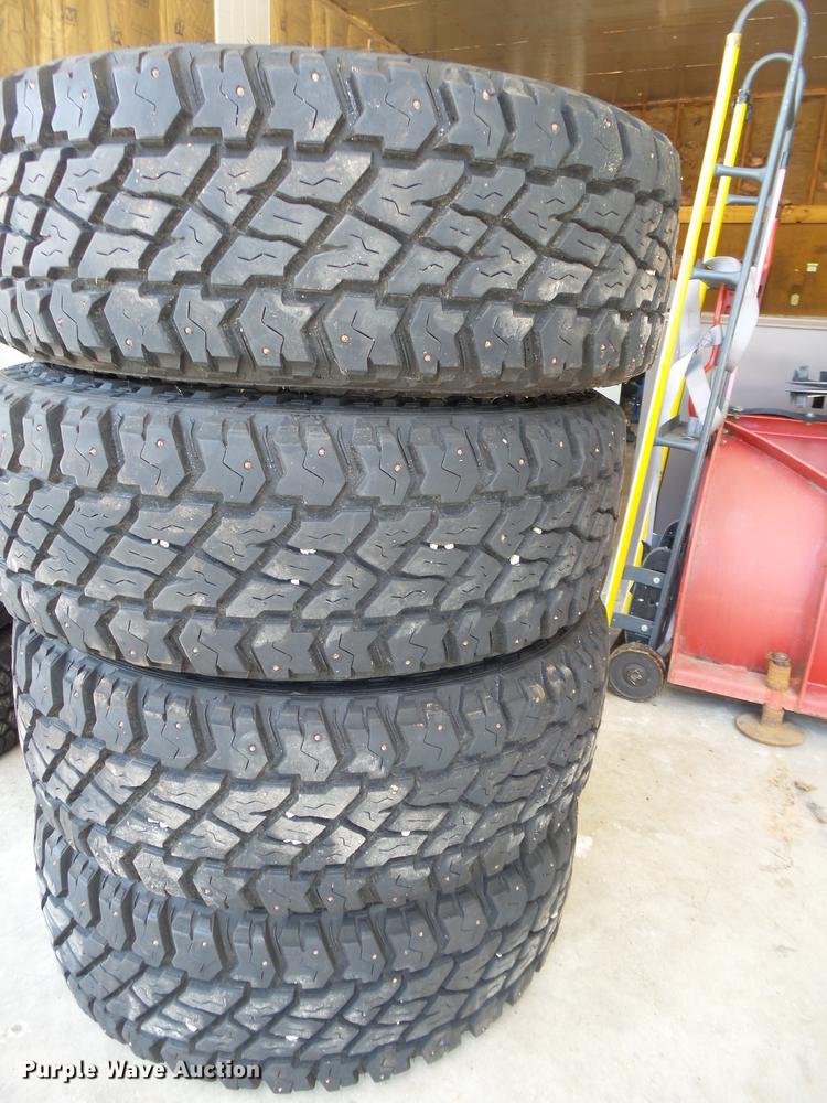 (4) Cooper LT265/70R17 studded tires