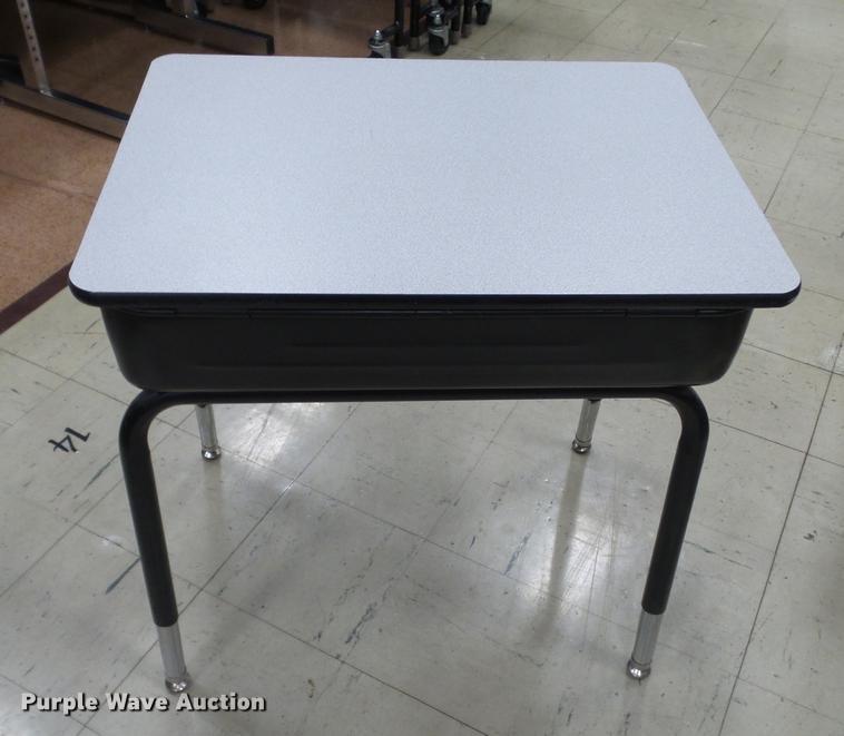 Approximately 100 student desks