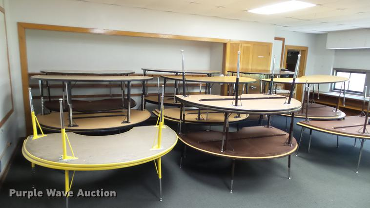 Approximately 20 half moon tables