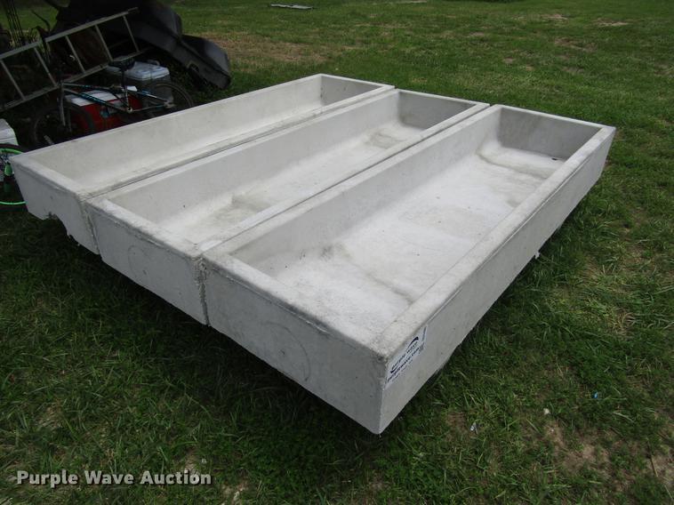 (3) concrete feed bunks