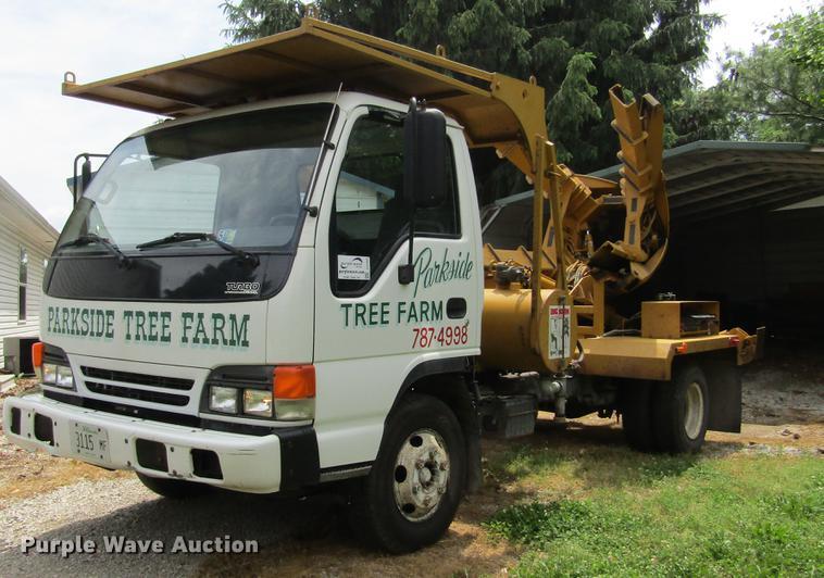 2002 Isuzu NPR truck with Big John tree spade