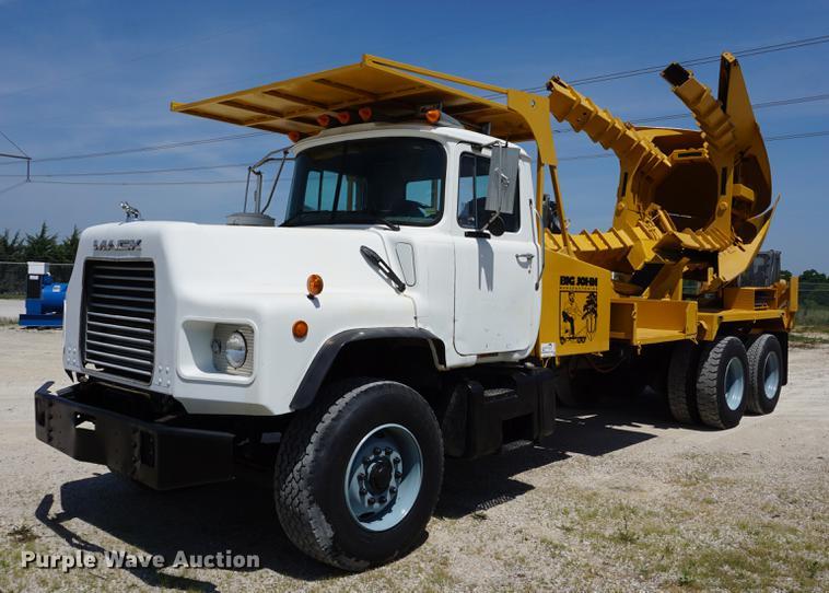 1998 Mack DM690S truck with Big John tree spade