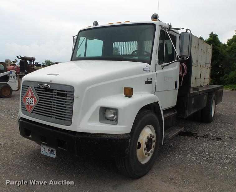 1998 Freightliner FL70 flatbed truck with water tank