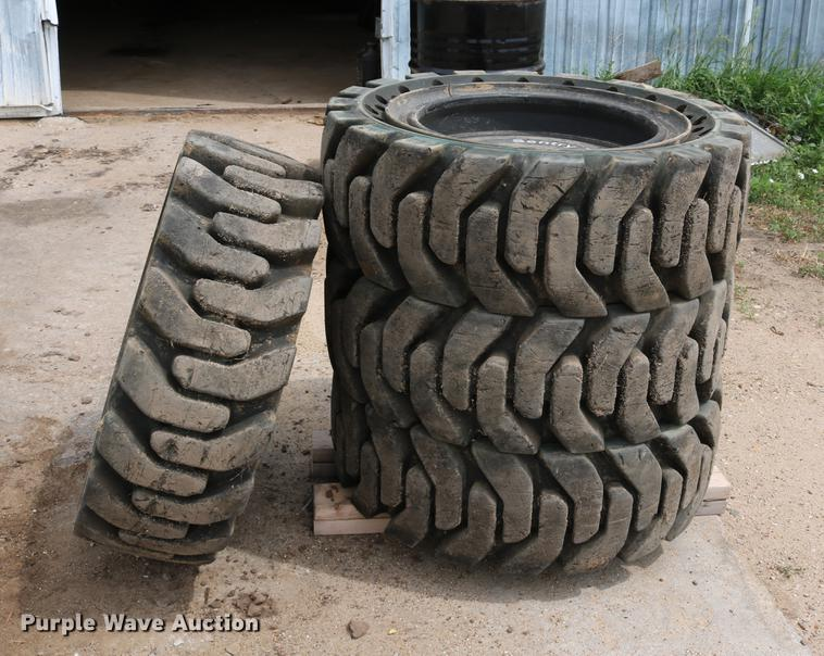 (4) 33x12-20 solid skid steer tires and wheels