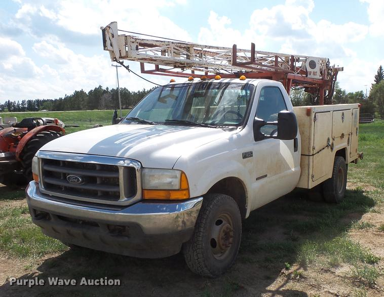 2001 Ford F350 Super Duty utility bed pickup truck with Jessen pump hoist
