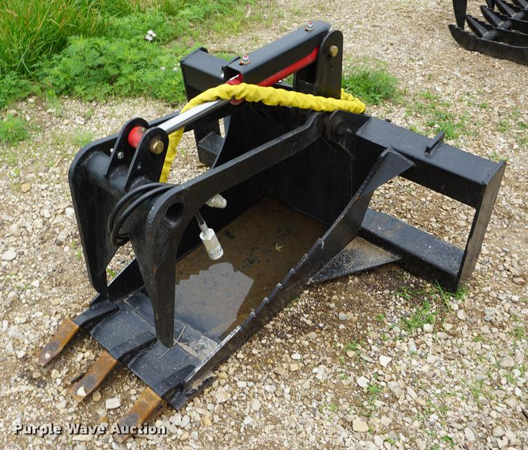 Stump bucket with grapple skid steer attachment