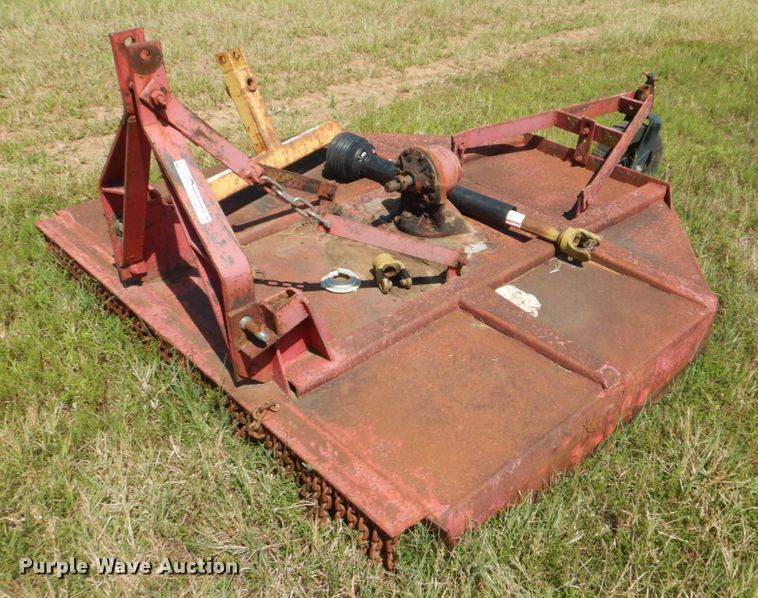 Rotary mower and bale spear
