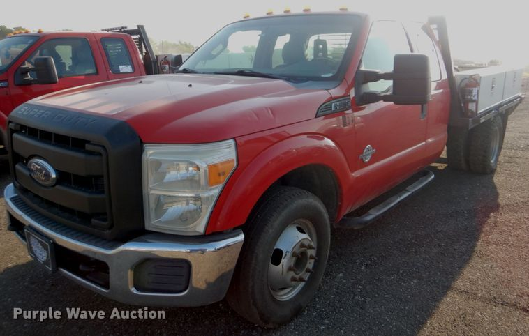 2011 Ford F350 Super Duty SuperCab flatbed pickup truck