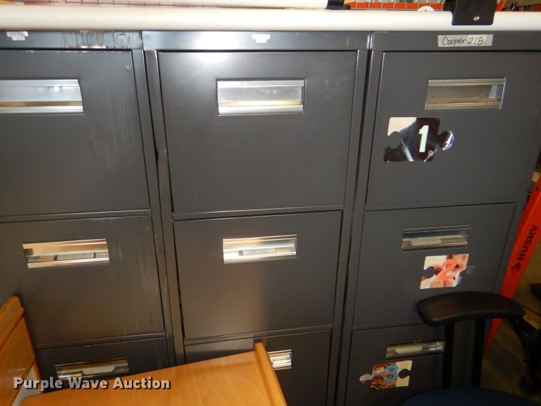 (4) four drawer metal filing cabinets