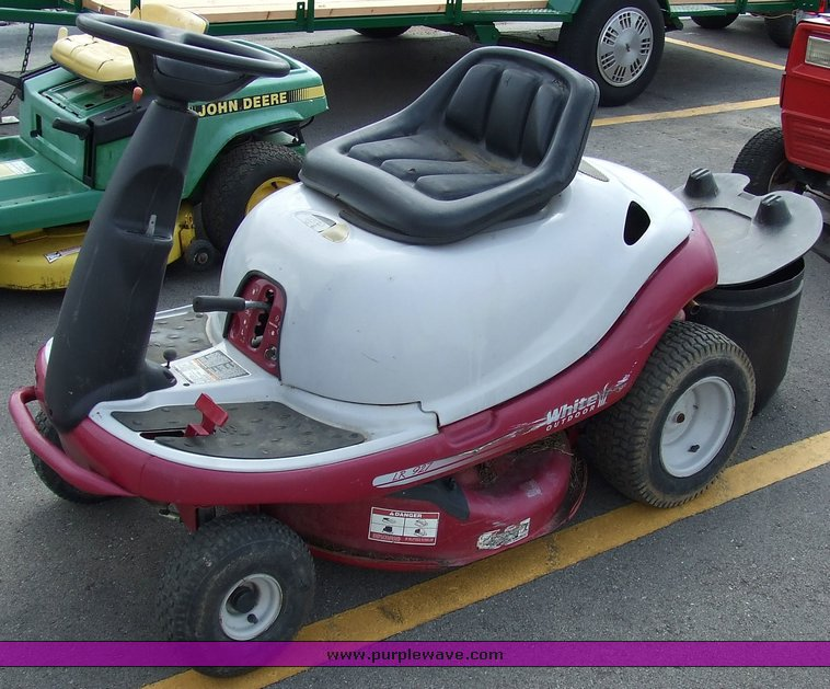 White outdoor yard bug riding mower with bagger assembly for Manhattan motors manhattan ks