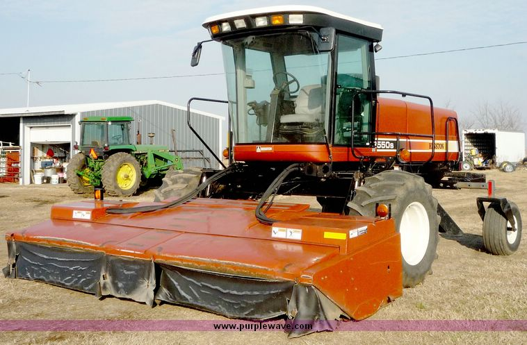 2002 Hesston 8550 self propelled swather | Item 5126 | SOLD!