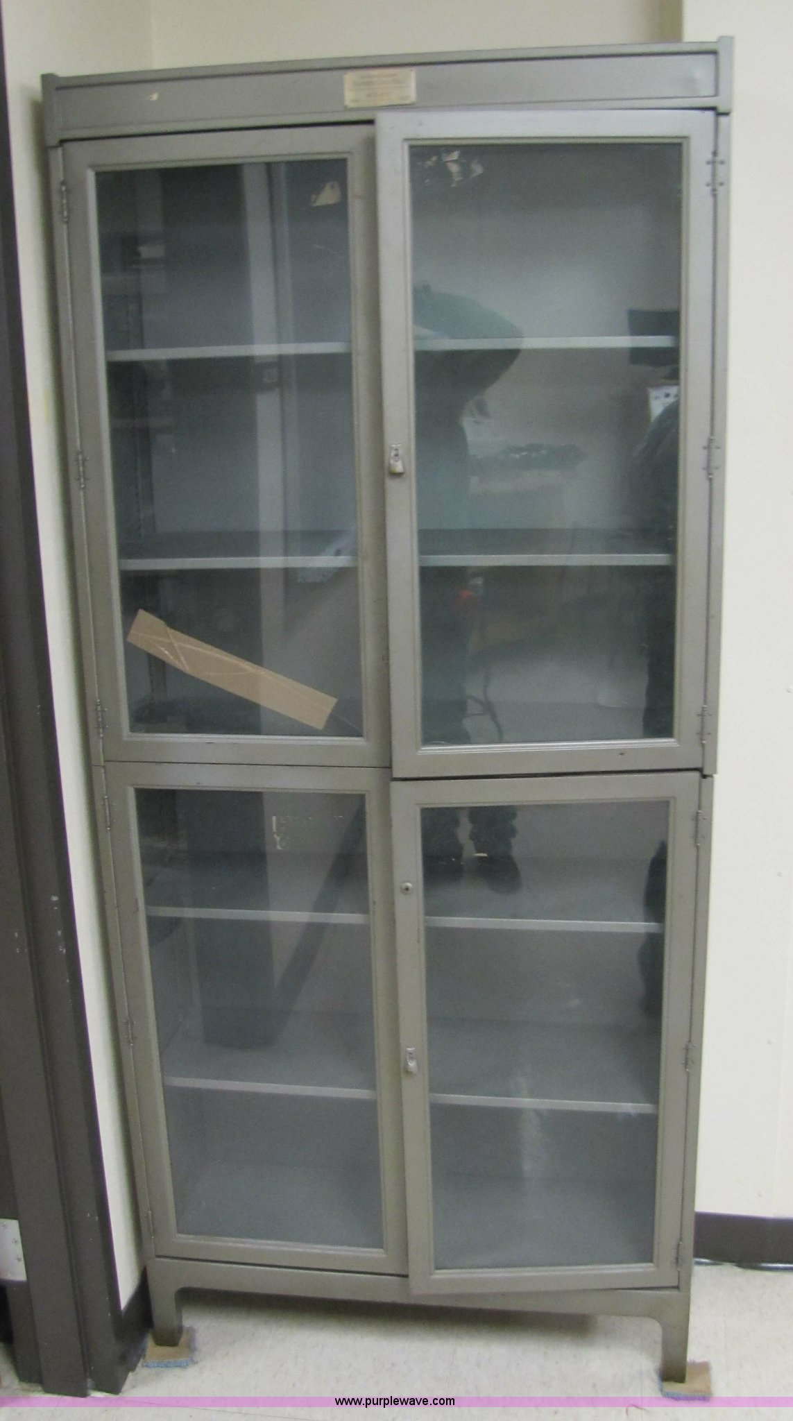 Metal Cabinet With Glass Doors Item 5217 Sold January 1