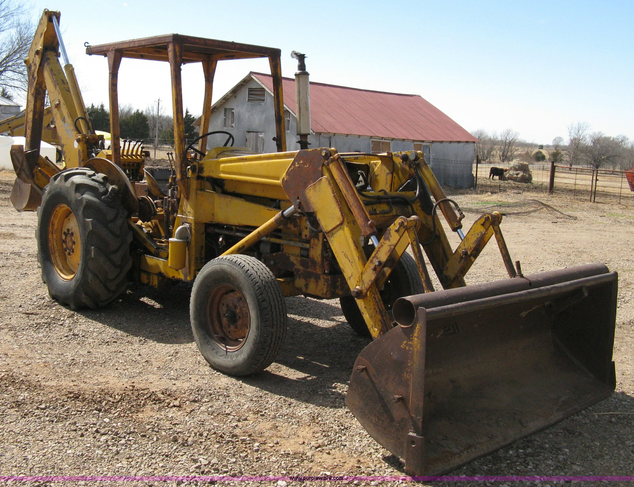 Massey-Ferguson 30 tractor with loader and backhoe attachmen
