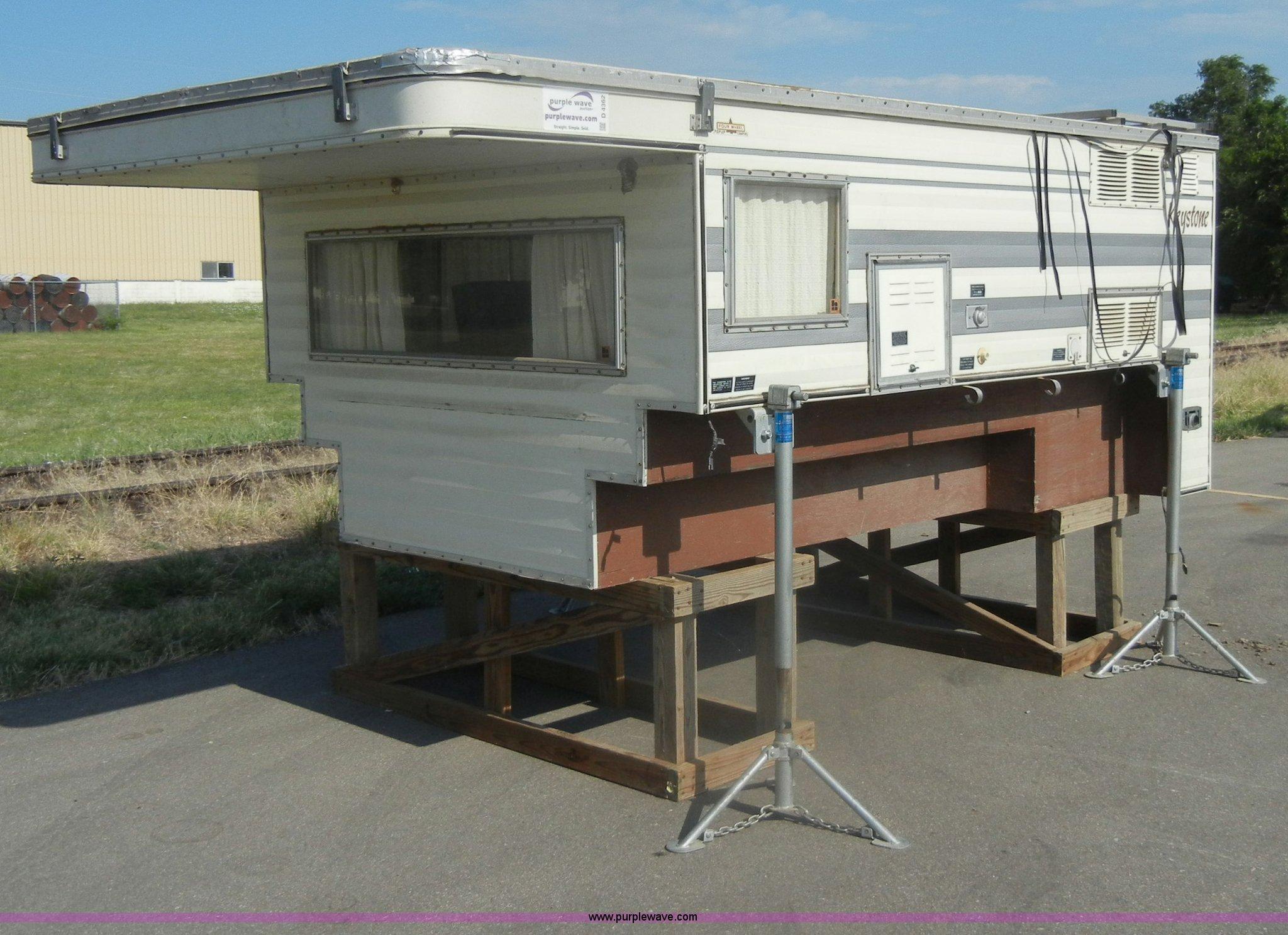 1983 Keystone four wheel pop-up truck camper   Item D4362  