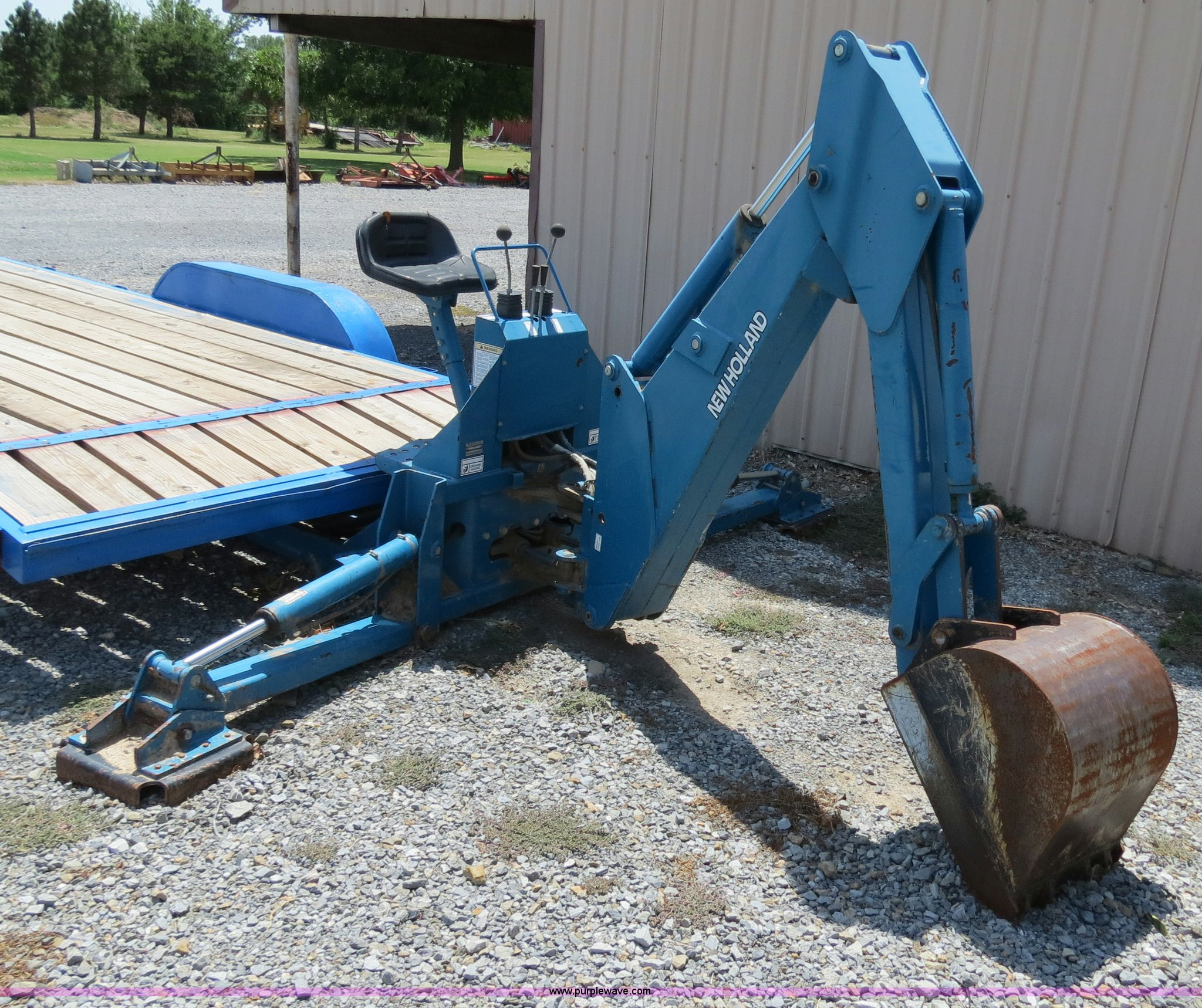 New Holland 759C backhoe attachment | Item C9746 | SOLD! Thu