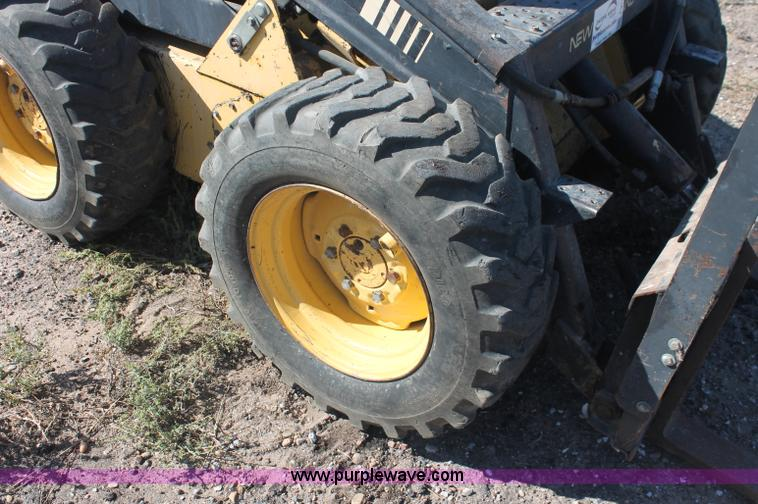 1988 New Holland L553 skid steer | Item F6137 | SOLD! Wednes