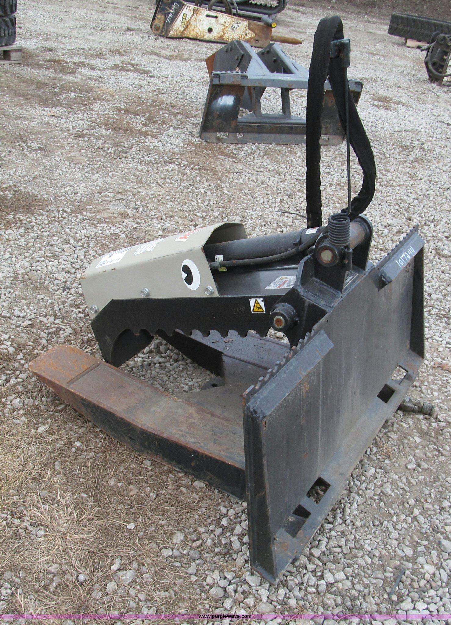 The Beak skid steer fork grapple   Item E5774   SOLD! Friday