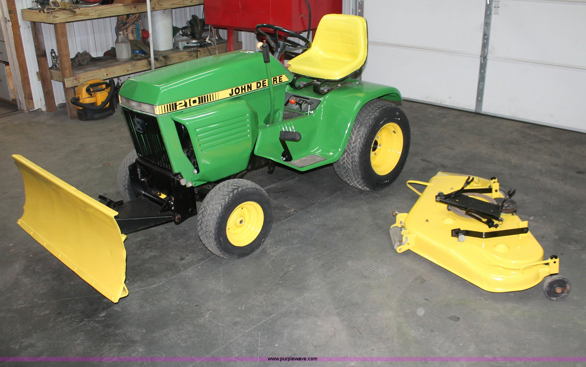 John deere 210 lawn mower item e2555 sold february 20 for Lawn tractor motors for sale