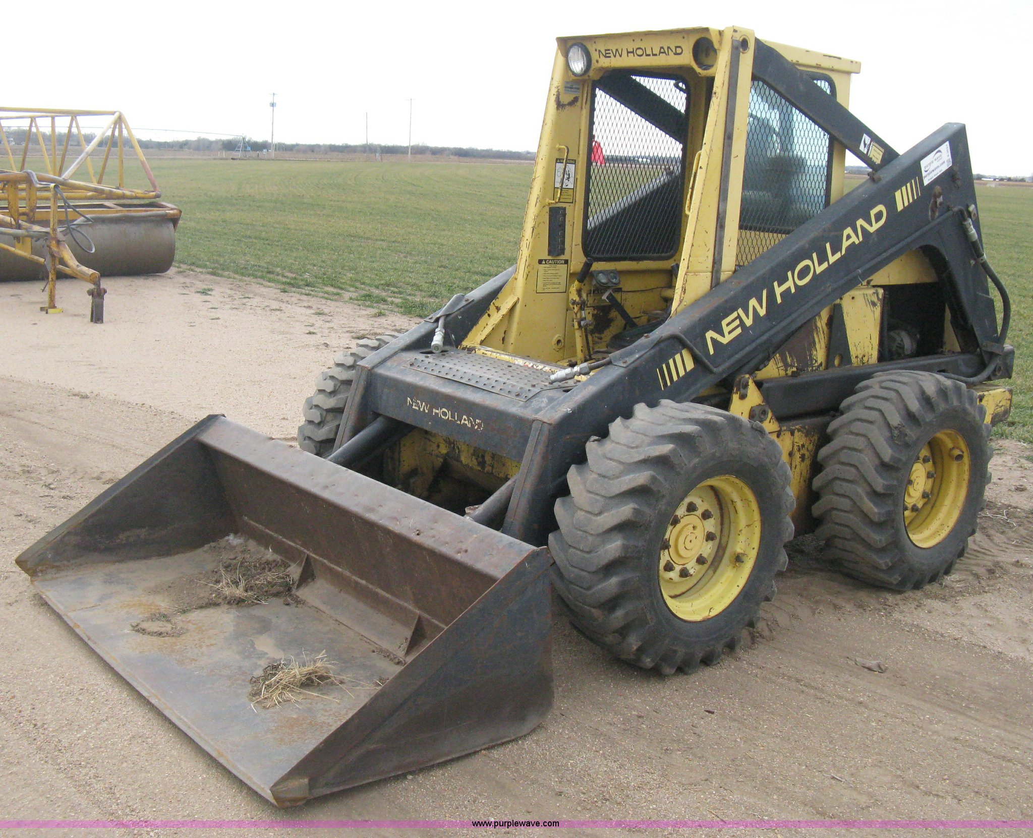 New Holland L785 skid steer | Item E3024 selling at SOLD